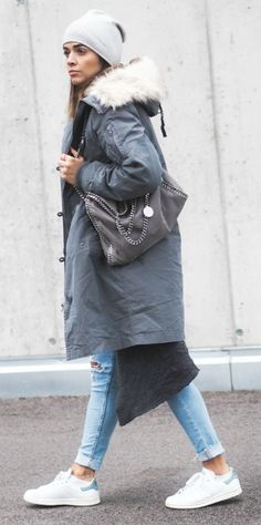 Nina + winter classic + super cosy grey parka + distressed jeans + sneakers + casual winter style + beanie + minimal jewellery + Nina's aesthetic. Parka: Asos, Jeans: H&M, Sneakers: Adidas Stan Smith, Shirt: Samsoe & Samsoe, Cardigan: Vila.