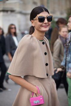 Love the coat! ...less keen on the bag.    STREET STYLE SPRING 2013: PARIS FASHION WEEK - Giovanna Battaglia wears her stunning camel coat with a fun-loving phone case.