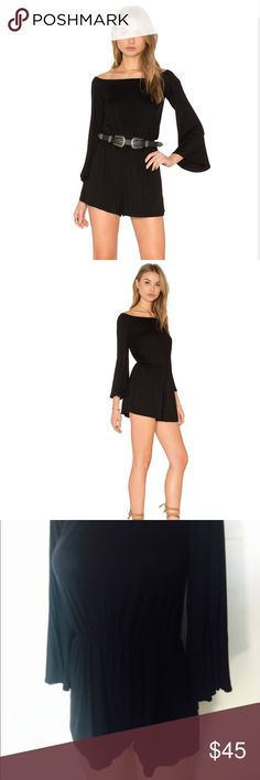 Amazingly comfortable NYTT black romper Sz S Amazingly comfortable NYTT black romper Sz S purchased on revolve website. Excellent condition worn 2-3 times. Elastic around the waist (will fit a 0-4) best NYTT Shorts