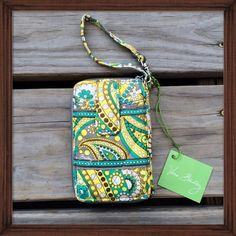 Vera Bradley Rare Wristlet Lemon Parfait Vera Bradley has unfortunately discontinued this bright fun pattern in this item. But you can still get it  NWT! Especially designed to fit large mobile phones, this zip-around also boasts four card slots, a zippered coin pouch, ID window and a bill slot. Use the adjustable wrist strap to carry as a handbag or a wristlet, or attach it to the handle of a larger bag. Vera Bradley Bags Clutches & Wristlets