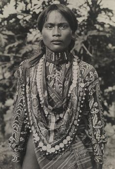 Philippines | A Kalinga man adorned in elaborate fabric, necklaces and ear disks.  Luzon Island.  ca. 1910s | ©Charles Martin