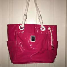 Pink Grace Adele purse Pink patent leather look, not real leather, real leather white straps, plenty of space in the bag with front pocket and side pockets. Zippers closed. Lightly used as pictured Grace Adele Bags Totes