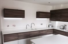 Lima J Brown and Porcelain kitchen with Corian worktops
