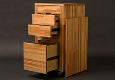 Living in a shoebox     Transforming cabinet with hidden table and chairs from Claudio Sibille