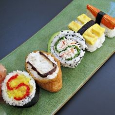 Spelling with sushi...oshinko roll, inari, inside-out California roll, tamago and kani!