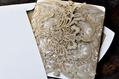 lace spray painted gold with glitter perhaps stiffened for invite wrap?????!!!!!!!!!!!!!!!!!!!***********************