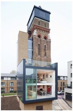 Converted Water tower in London by Agency  2 story glass extension