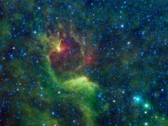 Dark Reflections in the Southern Cross  NASA's Wide-field Infrared Survey Explorer, or WISE, captured this colorful image of the reflection nebula IRAS 12116-6001. This cloud of interstellar dust cannot be seen directly in visible light, but WISE's detectors observed the nebula at infrared wavelengths.