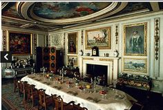The dining room in Queen Mary's Dolls' House at Windsor Castle.  Watch the videos.
