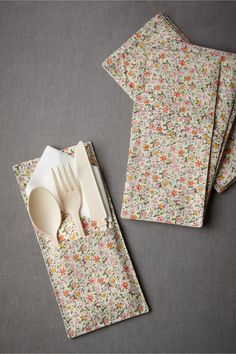 utensil/napkin holder - one pocket to hold flatware, a second to hold the napkin.