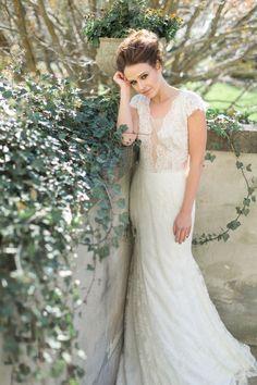 Lace plunging illusion neckline wedding dress: http://www.stylemepretty.com/canada-weddings/ontario/cambridge-ontario/2017/03/23/moody-fall-wedding-inspiration/ Photography: Corina V. - http://corinavphotography.com/