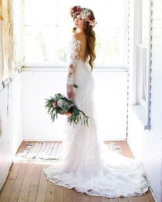 From the lace sleeves, to the boho floral crown, to the gorgeous illusion backless dress, we are obsessed with this beauty by Stella York!