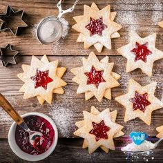 Christmas Linzer cookies with raspberry jam by nblxer. Christmas Linzer cookies with raspberry jam on a rustic wooden background Christmas Candy, Christmas Baking, Christmas Time, Star Cookies, Holiday Cookies, Galletas Cookies, Cookies Et Biscuits, Hanukkah, Sweet Recipes