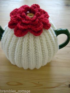 Hand-Knitted-Tea-Cosy-with-Deep-Red-Crochet-Flower-To-Warm-a-Med-T-Pot