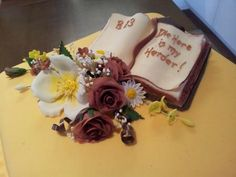 Bible and flowers on golden birthday cake for a man