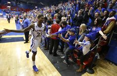 Kansas fans reach to slap hands with Ben McLemore as he exits the floor ~ 1.9.13