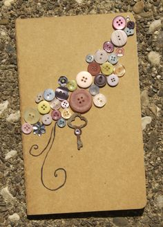 Lovely journal idea! I love working with buttons....i would be happy if i had a hug jar of buttons