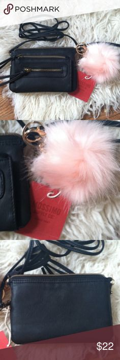 NWT Mossimo Supply Co cross body purse •New with tag •Many storage compartments •Faux leather •Longer strap is removable which turns the purse into a Wristlet instead •Comes with a faux fur Pom Pom Keychain/ charm (Pink) •Color: Black •Brand: Mossimo Supply Co •NO TRADES Mossimo Supply Co Bags Crossbody Bags