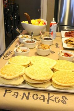 Use craft or butcher paper to line your pancake bar. You can write on it with a permanent marker to label each ingredient, and it makes for easy clean up. | Anthony Bourdain Made A Cute Pancake Bar For His Daughter's Slumber Party