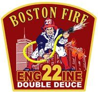 Boston - Engine 22 collars another junior fire fighter.