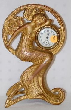 Jennings Brothers Art Nouveau Desk Clock: the case with lady figure and poppies is signed Eugene Klein