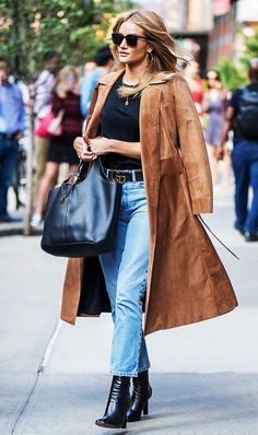 Rosie Huntington-Whiteley always looks chic with a trench tossed over her shoulders.