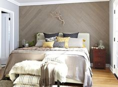 Apply Stikwood Wall Paneling In one day make one change to add modern, rustic style to a boring bedroom wall with this sleek, single chevron design.