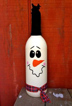 This snowman wine bottle decoration will keep your rooms warm during those cold winter months. Two black eyes, a carrot nose and a squiggly mouth