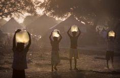 Children collect water for their families in the half-light of sunset.  Oxfam is currently producing over 300,000 litres of clean water a da... via Oxfam East Africa