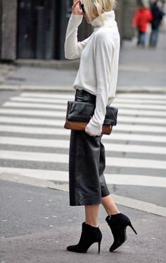 Fashion: Fall / Winter. Black leather culottes with ankle boots.