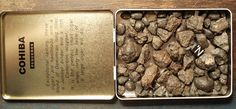 Cohiba cigar tin filled with small stony meteorites.  From the Galactic Stone Collection.  Not for sale.