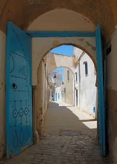 A lonely stretch of back street along the far side of the Tunis medina during the midday sun