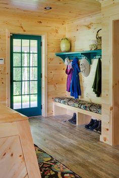 Now this is a mudroom! Woodmeister Master Builders worked with interior designer Marcia Summers to create the super-functional space for a lakeshore home in New Hampshire. The active homeowners wa… Knotty Pine Decor, Knotty Pine Walls, House Of Turquoise, Log Home Interiors, Rustic Entryway, Cabin Kitchens, Kitchen Cabinet Design, Beige Walls, Interior Exterior