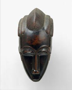 Portrait Mask (Gba gba)  before 1913 Geography: Côte d'Ivoire, central Côte d'Ivoire Culture: Baule peoples Medium: Wood Dimensions: H. 10 1/4 x W. 4 7/8 x D. 4 1/8 in. (26 x 12.4 x 10.5 cm) READ note