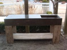 Concrete Botany/Potting Bench Sink with Wood Plank Base Suitable for year round outdoor use. Available in custom color and sizes.