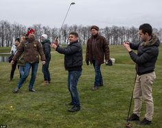 Protesters try to play on a golf course at the Ukrainian President Yanukovych's countryside residence in Mezhyhirya, Kiev's region. Ukrainia...