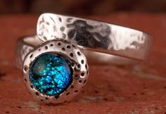 Cool ring with dichroic cabochon.