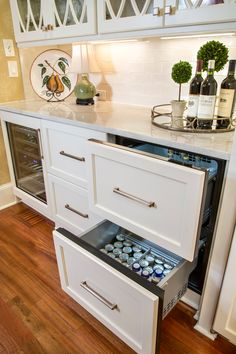 Pull out Refrigerator Drawers with champagne bronze hardware.