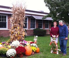Head Custodian Garry VandeWeert and his wife, retired bus driver Joan VandeWeert, decorate the front yard of the Scotchtown Avenue Elementary School with a beautiful fall scene, complete with pumpkins, mums, corn stalks and scarecrows. The VandeWeerts have created this fall display at SAS for several years.