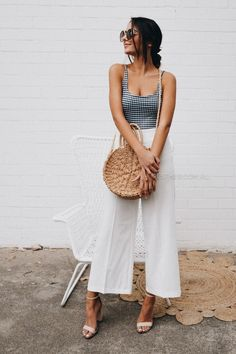 Print fitted top with solid color flair pants. Add a summer bag and hat for the perfect summer outfit