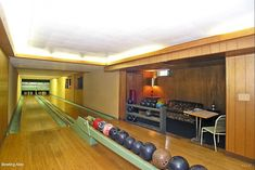 Basement bowling alley in 1962 Michigan time capsule house for sale.  I don't know how to state as strongly my feelings for how cool I think this is.