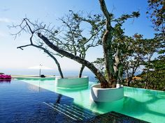 This pool shows the use of ambient light in vibrant hues even in the daytime.