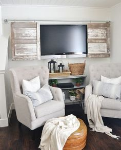 hidden tvs - Sliding vintage barn style doors hung on a DIY plumbing pipe track - Liz Marie Blog via Atticmag