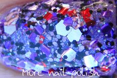 small black and lavender hexes, large lavender hexes, sprinkling of red square glitter mix of medium darker purple hexes.