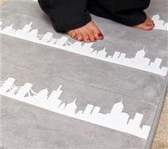 Use Cricut® Iron-on to add a fun cityscape to your bath décor!