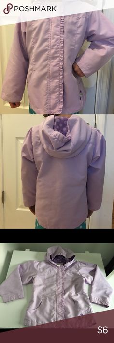 Circo Girls 5T Spring Jacket Color is a soft pretty purple. Photo doesn't really capture that very well. Has cute ruffle detail that covers the zipper & a small embroidery at the bottom underneath left pocket (right when looking at it). Cuffs have slight hint of dirt marks, barely noticeable unless you are looking closely. Jackets & Coats