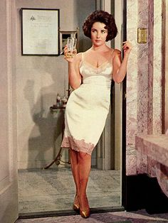 Elizabeth Taylor in Butterfield 8. The lady could sure work a simple slip... We here at Boudoir Bed Bath appreciate how sexy this is without being revealing.