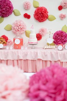 A PINK STRAWBERRY 4TH BIRTHDAY PARTY featured on Kara's Party Ideas- www.KarasPartyIdeas.com! So cute! Lovely dessert table, too. Love the flowers made out of tissue poms!