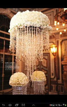 Wedding decorations L O V E this high chandeliers on base, and the top cloud of flowers It's the icing on cake!