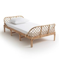 KATSUKI Child's Rattan Bed AM.We love this vintage-look rattan bed featuring soft, curved lines for a cosy night's sleep. Available in two mattress sizes: 70 & 90 x Childrens Bedroom Furniture, Childrens Beds, Kids Furniture, Cheap Furniture, Furniture Design, Rattan Daybed, Rattan Furniture, Daybeds, Madeira Natural